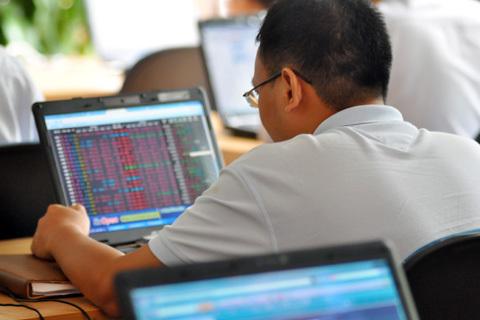 Thị trường chứng khoán có thể chịu nhiều thử thách trong tuần sau. Ảnh: N.M