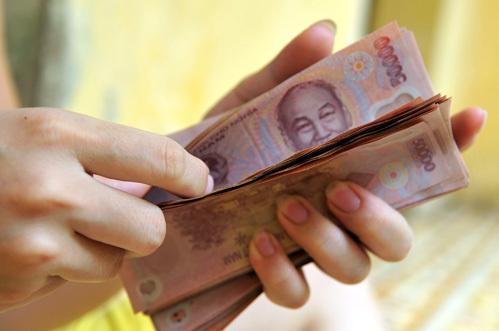 Lương tối thiểu đã tăng 8 lần từ năm 2003 đến nay. Ảnh minh họa: Hoàng Hà