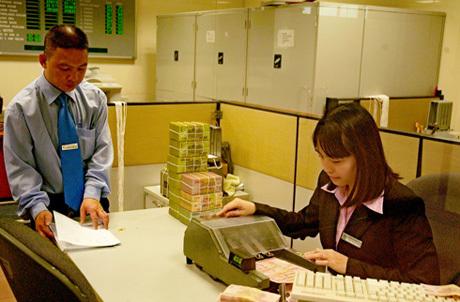 Lợi nhuận sau thuế 9 tháng của Vietcombank không còn tăng trưởng dương so với cùng kỳ. Ảnh: Hoàng Hà.