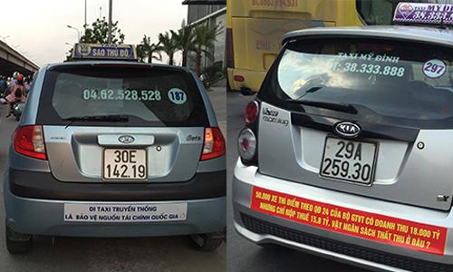 Nhiều taxi truyền thống căng băng rôn phản đối taxi công nghệ. Ảnh: Anh Tú.