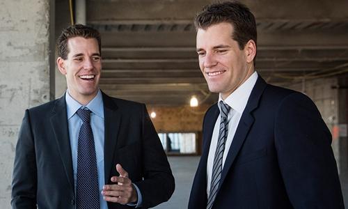 Anh em nhà Winklevoss đã có tài sản tỷ USD nhờ Bitcoin. Ảnh: AFP