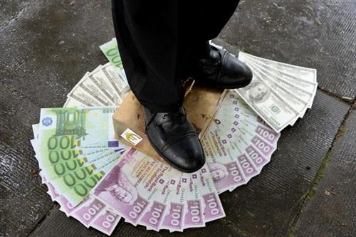 Những người giàu nhất thế giới đang ngày càng bỏ xa top cuối. Ảnh:AFP