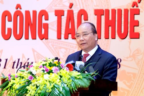 Thủ tướng Nguyễn Xuân Phúc đề nghị ngành thuế loại bỏ tiêu cực, tham nhũng. Ảnh: VGP.