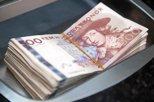 Tiền mặt đang dần biến mất vì thanh toán điện tử tại Thụy Điển. Ảnh: Bloomberg