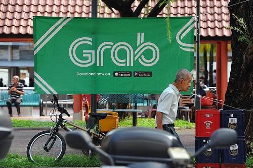 Grab là hãng cung cấp dịch vụ đi chung xe lớn nhất Đông Nam Á. Ảnh: Business Times