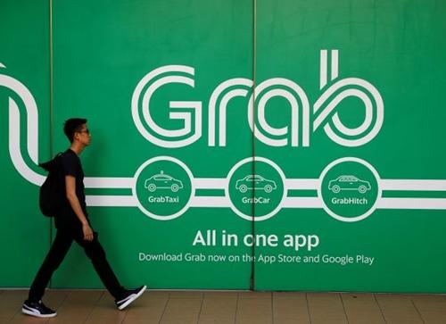 Bên ngoài văn phòng làm việc của Grab tại Singapore. Ảnh: Reuters.