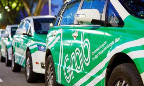 Taxi gắn biển Grab hoạt động tại Việt Nam.