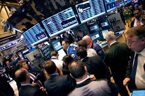 Trader trên sàn chứng khoán New York (NYSE). Ảnh: AFP