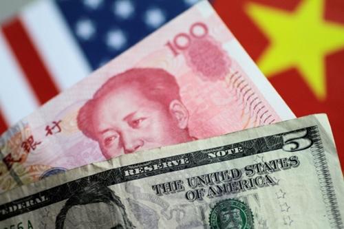 NDT quý trước tăng giá 0.8% so với USD. Ảnh: Reuters