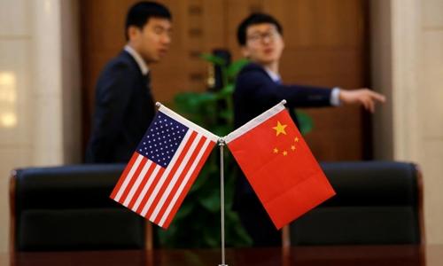 Cờ Mỹ và Trung Quốc trong một lễ ký kết tại Bắc Kinh cuối tháng trước. Ảnh: Reuters