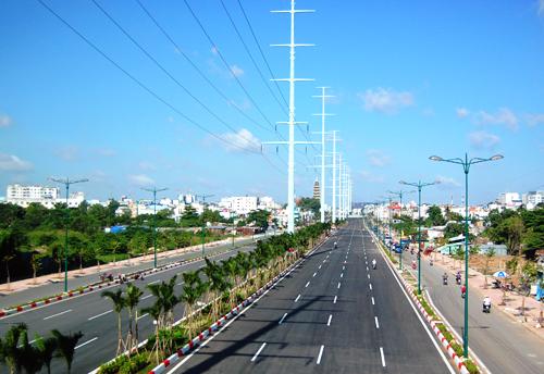 Đường Phạm Văn Đồng - đường nội đô đẹp nhất TP HCM, tổng số vốn đầu tư 495 triệu USD - là dự án đầu tiên tại Việt Nam do đơn vị nước ngoài thực hiện theo hình thức BT. Ảnh: Hữu Công.
