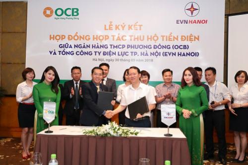 Buổi ký kết giữa Ngân hàng Phương Đông và EVN Hà Nội vào 30/5.