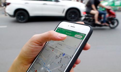 Bộ Giao thông chưa có chủ trương mở rộng ứng dụng Grab ra ngoài 5 địa phương thí điểm. Ảnh: CNBC