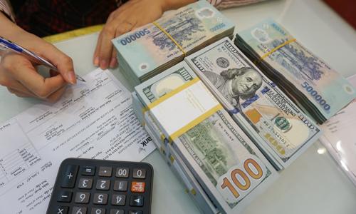 Tỷ giá USD/VND vừa trải qua đợt sóng tăng mạnh. Ảnh: Anh Tú.