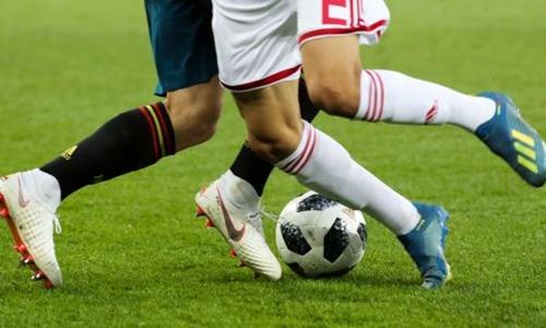 Hai cầu thủ đi giày Adidas và Nike tại World Cup năm nay. Ảnh: TASS