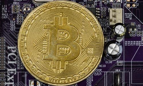 Giá Bitcoin tăng hơn 11% trong một ngày. Ảnh: AFP