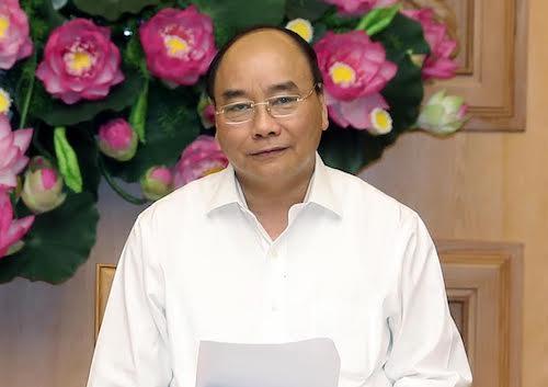 Thủ tướng Nguyễn Xuân Phúc chỉ đạo tại cuộc họp Hội đồng tư vấn chính sách tiền tệ quốc gia chiều 18/7. Ảnh: VGP