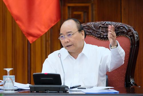 Thủ tướng Nguyễn Xuân Phúc chỉ đạo tại cuộc họp thường trực Chính phủ chiều 25/7. Ảnh: VGP
