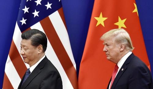 Chủ tịch Trung Quốc - Tập Cận Bình và Tổng thống Mỹ - Donald Trump. Ảnh: Kyodo