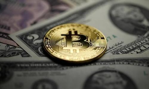 Tiền ảo Bitcoin ngày càng được dùng phổ biến trong giao dịch và thanh toán. Ảnh: Reuters