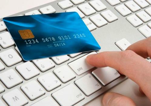 Ngành điện lực đang đẩy mạnh việc thanh toán tiền điện qua ngân hàng.