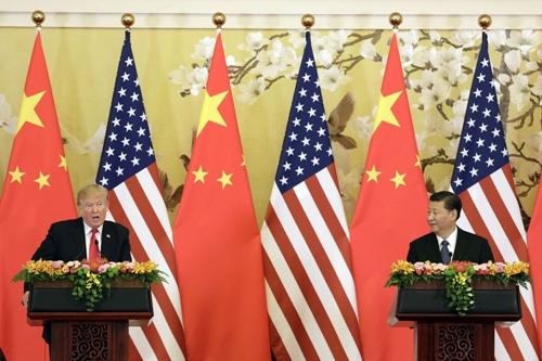 Ông Trump và ông Tập trong một cuộc họp báo tại Bắc Kinh năm ngoái. Ảnh: Bloomberg