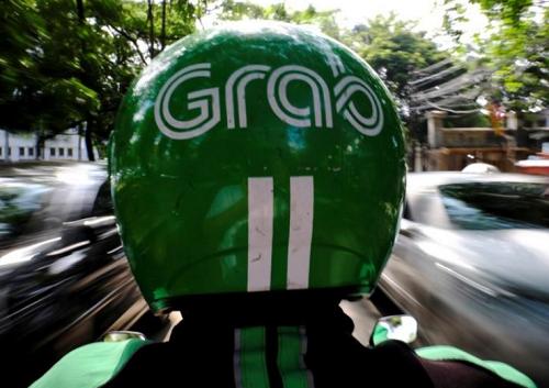 Một tài xế Grab trên đường phố thủ đô Jakarta, Indonesia. Ảnh: Reuters