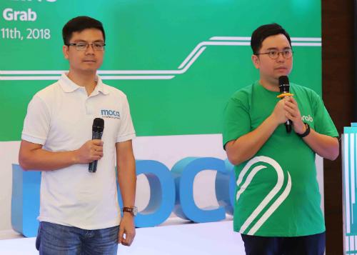 Ông Trần Thanh Nam - Sáng lập viên và Giám đốc Moca (bên trái) và ông Nguyễn Tuấn Anh -Tổng giám đốc Grab Financial Group Việt Nam (bên phải).