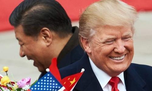 Chủ tịch Trung Quốc - Tập Cận Bình và Tổng thống Mỹ - Donald Trump tại Bắc Kinh. Ảnh: AFP