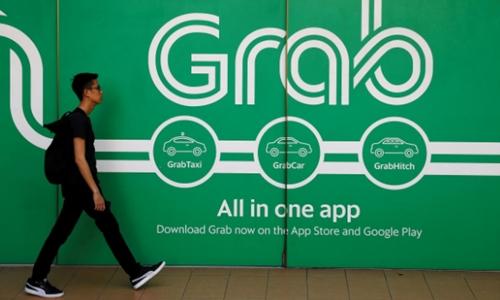 Bên ngoài một văn phòng của Grab tại Singapore. Ảnh: Reuters