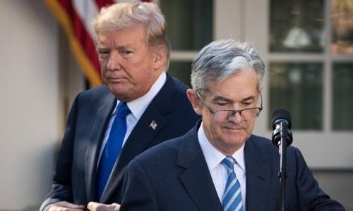 Tổng thống Mỹ - Donald Trump và Chủ tịch Fed - Jerome Powell. Ảnh: AFP