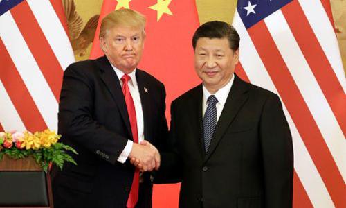 Tổng thống Donald Trump trong chuyến công du Trung Quốc tháng 9 năm ngoái. Ảnh: Bloomberg