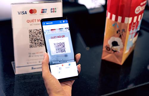 Thanh toán quét QR bằng ứng dụng Sacombank Pay sẽ được ưu đãi đặc biệt khi mua bắp, vé xem phim