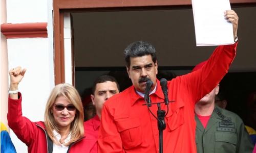 Tổng thống Venezuela - Nicolas Maduro và vợ. Ảnh: Reuters