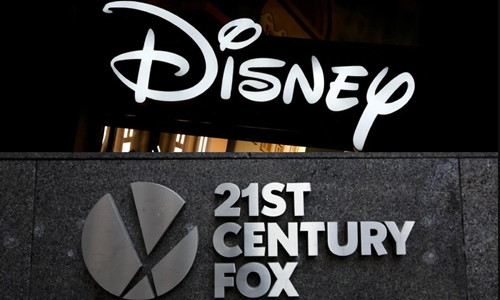 Logo hai hãng truyền thông The Walt Disney Company và 21st Century Fox. Ảnh: New Straits Times