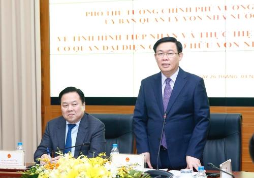 Phó thủ tướng Vương Đình Huệ và Chủ tịch Ủy ban Quản lý vôn tại doanh nghiệp - ông Nguyễn Hoàng Anh.