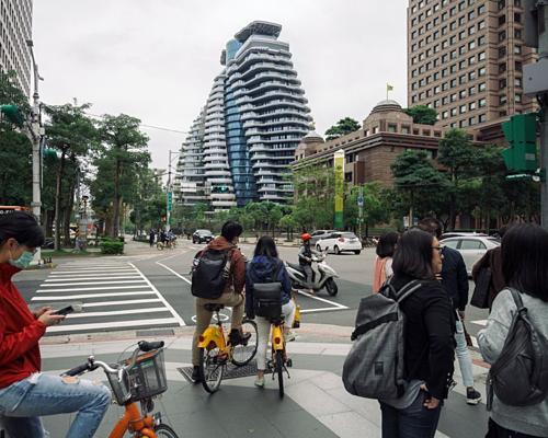 Tòa chung cư xoắn ốc Tao Zhu Yin Yuan với giá mỗi căn 32 triệu USD ở Đài Bắc. Ảnh: Bloomberg