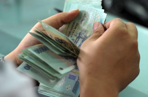 Hoạt động cho vay tiền mặt của các công ty tài chính sẽ bị siết chặt theo dự thảo thông tư đang xin ý kiến của Ngân hàng Nhà nước. Ảnh: LC