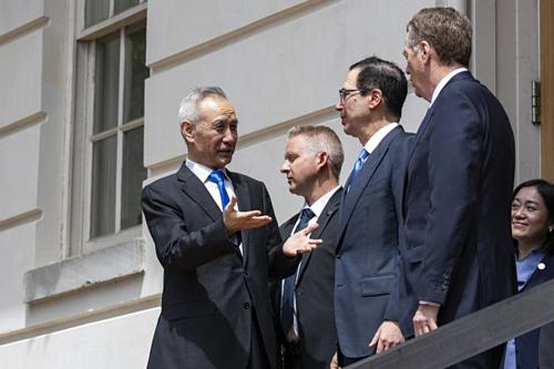 Lãnh đạo Mỹ vàTrung Quốc trong vòng đàm phán tuần trước tại Washington. Ảnh: AFP