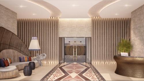 Không gian sảnh vừa sang trọng, vừamang đậm nétvăn hóa truyền thống đương đại với họa tiết trống đồng và bàn lễ tân cách điệu.
