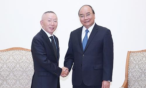 Ông chủ Uniqlo gặp Thủ tướng Nguyễn Xuân Phúc chiều 18/7. Ảnh: VGP