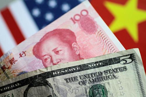 Đồng nhân dân tệ đã vuowjtr qua mốc quan trọng 7 CNY đổi 1 USD. Ảnh: Reuters