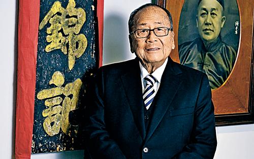 Ông Lee Man Tat năm 2013. Ảnh: Imaginechina