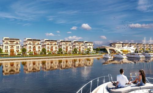 Hơn 60% diện tích dự án là mặt nước cảnh quan và cây xanh. Ảnh phối cảnh.