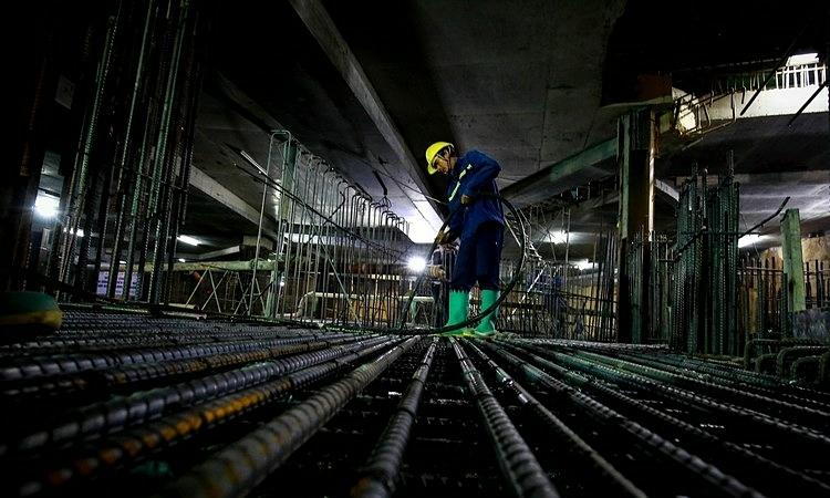 Công nhân thi công tầng hầm dự án Hilton Saigon năm 2018. Ảnh: Coteccons