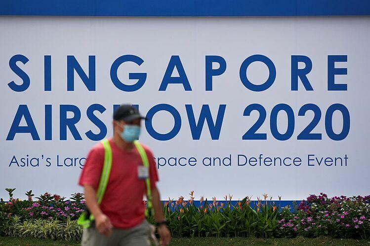 Biển quảng cáo Singapore Airshow bên ngoài Trung tâm Triển lãm Changi. Ảnh: Bloomberg