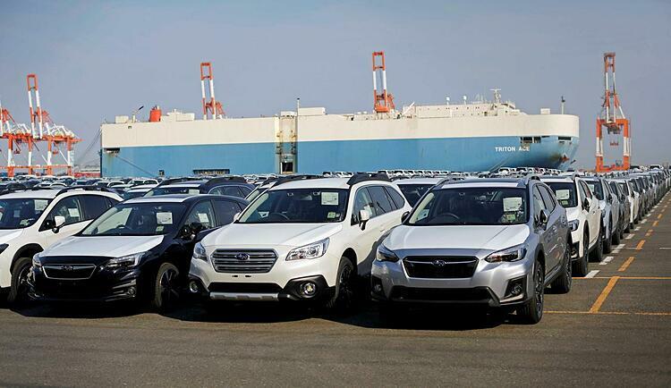 Xe hơi chờ xuất khẩu tại một cảng của Nhật Bản. Ảnh: Reuters