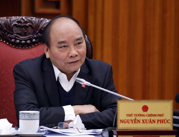 Thủ tướng chủ trì cuộc họp tháo gỡ khó khăn với ngành mía đường ngày 18/2. Ảnh: VGP