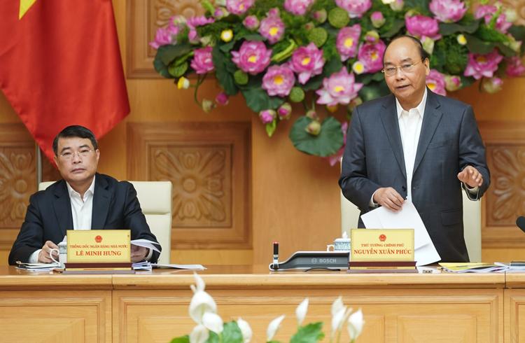 Thủ tướng Nguyễn Xuân Phúc chủ trì cuộc họp Hội đồng tư vấn chính sách tài chính, tiền tệ ngày 25/2. Ảnh: VGP