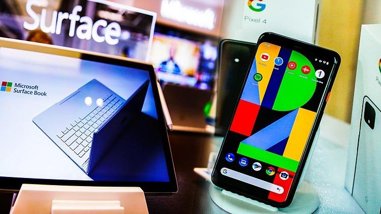 Một mẫu laptop Surface của Microsoft và một mẫu điện thoại Pixel của Google. Ảnh: Reuters